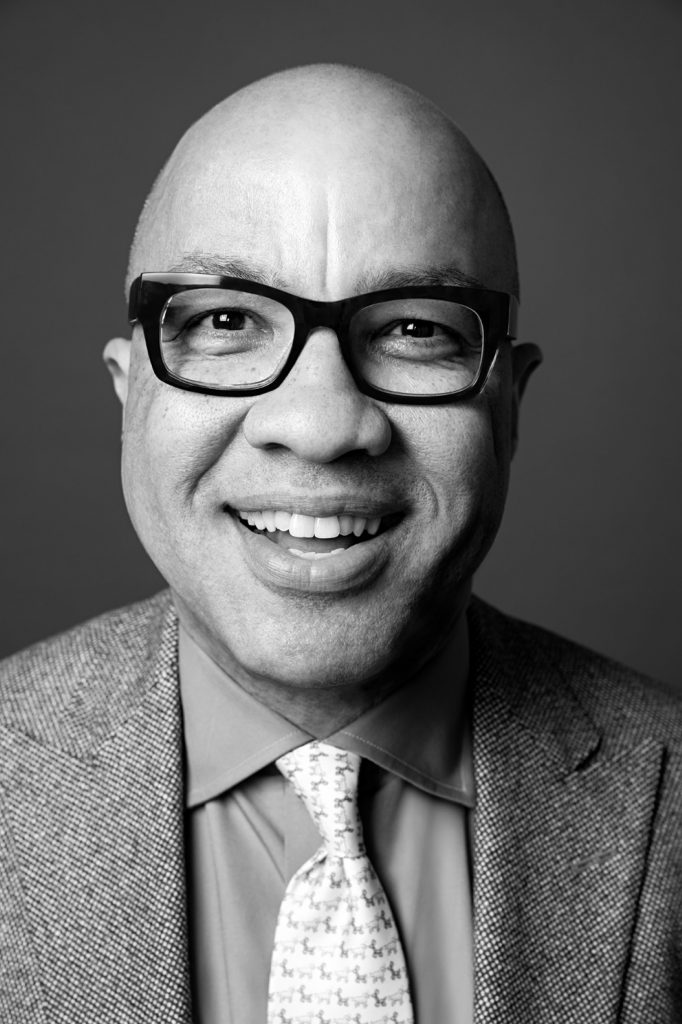 Darren Walker black and white portrait with glasses and tie